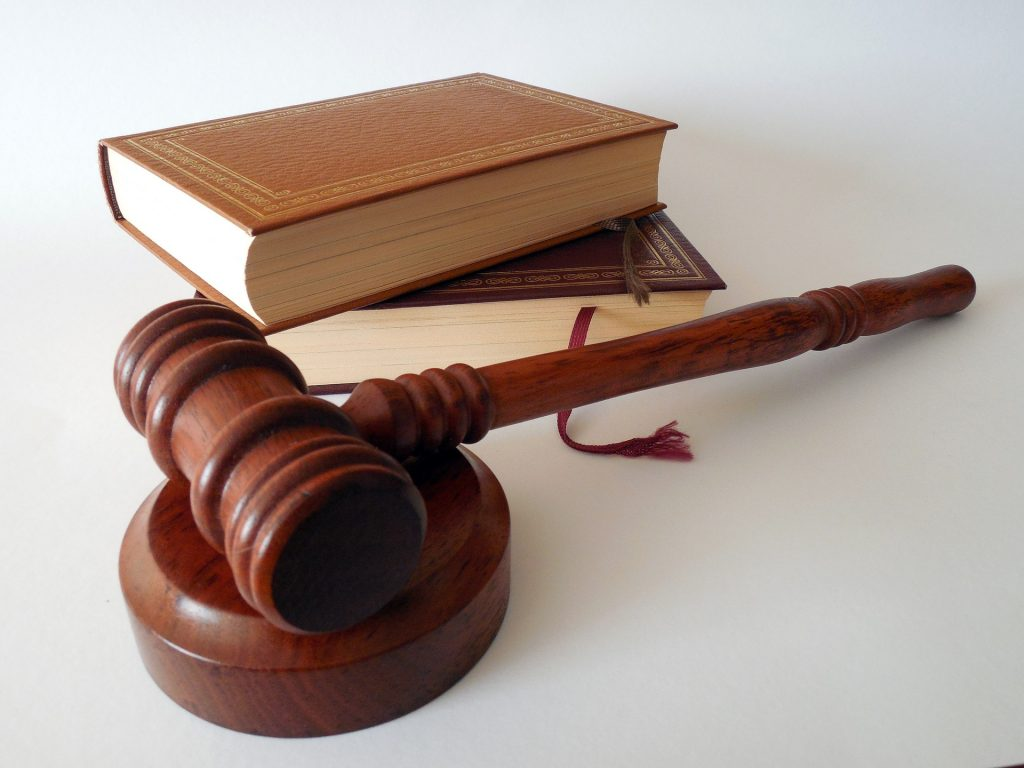 Photo of a gavel and law books.