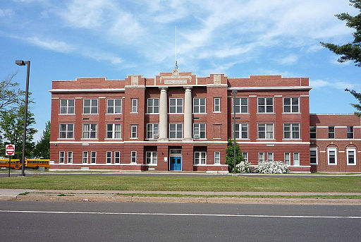 Photo of a tall brick school building.